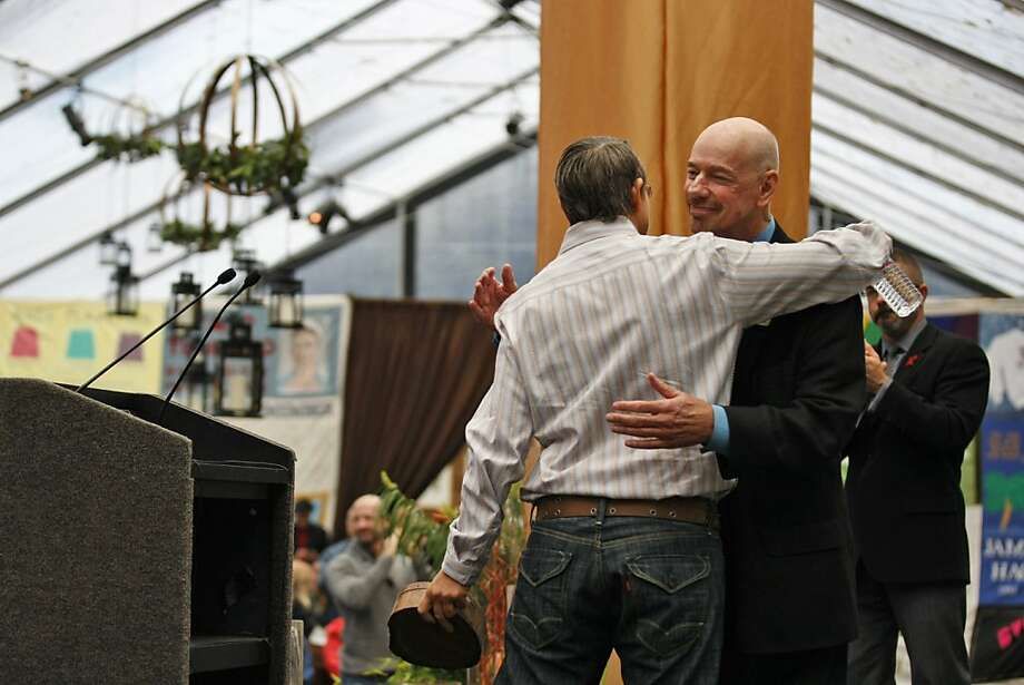 Gina Gatta, long-time HIV/AIDS activist and 12-year member of the Board of Directors for the National AIDS Memorial Grove, hugs Thom Weyand of the National AIDS Memorial Board after receiving the Local Unsung Hero Award at the 19th Annual World AIDS Day commemoration. Saturday, Dec. 1, 2012 marked the 19th Annual World AIDS Day commemoration, with a national AIDS memorial service at the AIDS Memorial Grove in Golden Gate Park. Photo: Rashad Sisemore, The Chronicle