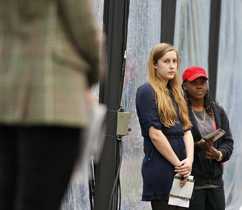 National AIDS Memorial Youth Scholarship Program winners Annie Wilson (left) from Lick-Wilmerding High School in San Francisco, Calif., and Nzinga Hyacinthe from Community University of New York, Lehman College wait to read out their winning essays during the 19th Annual World AIDS Day commemoration Saturday, Dec. 1, 2012. A total of $15,000 in scholarships were awarded by UnitedHealthcare to six recipients from four states for the 19th annual World AIDS Day commemoration, with a national commemoration at the Grove designed to remember the dead and raise awareness for the living. Photo: Rashad Sisemore, The Chronicle