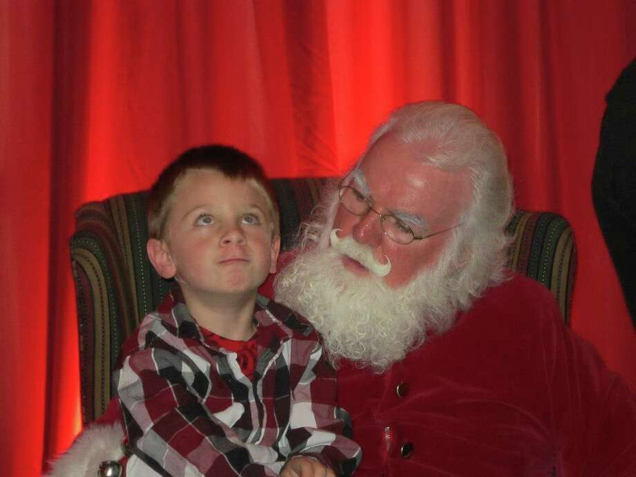 This is a picture of my 5 yr old grandson, Seth Ribet, taken at the annual Dickens Holiday Festival on 11/25/12 held at Longfellows Inn & Restaurant in Saratoga.   (Kyle Kindlon) Colonie He was thinking very hard what to tell Santa he wanted! I wanted to get a shot of both Seth and his 21 month old sister, Skyler, but she wanted no part of Santa!