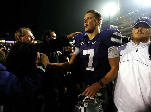 Quarterback Collin Klein #7 of the Kansas State Wildcats celebrates with fans who stormed the field following the Wildcats' 42-24 victory over the Texas Longhorns at Bill Snyder Family Football Stadium on December 1, 2012 in Manhattan, Kansas. Photo: Jamie Squire, Getty Images / 2012 Getty Images