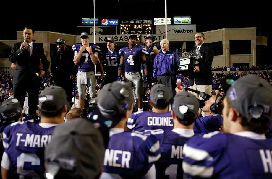 Head coach Bill Snyder and the Kansas State Wildcats are presented with the Big 12 Championship trophy following the Wildcats' 42-24 victory over the Texas Longhorns at Bill Snyder Family Football Stadium on December 1, 2012 in Manhattan, Kansas. Photo: Jamie Squire, Getty Images / 2012 Getty Images