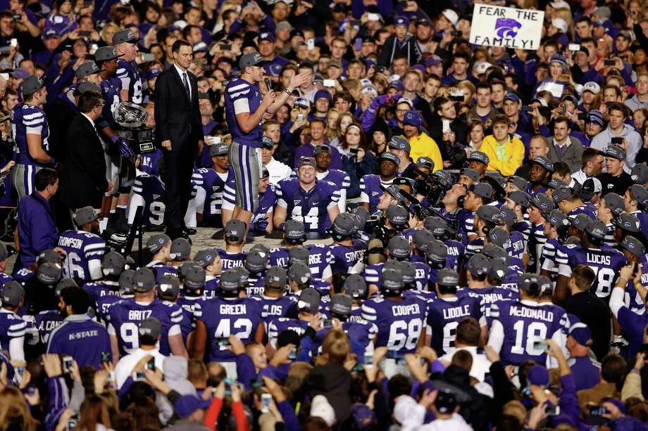Quarterback Collin Klein #7 of the Kansas State Wildcats addresses players and fans during the Big 12 Championship trophy ceremony following the game against the Texas Longhorns at Bill Snyder Family Football Stadium on December 1, 2012 in Manhattan, Kansas. Photo: Jamie Squire, Getty Images / 2012 Getty Images