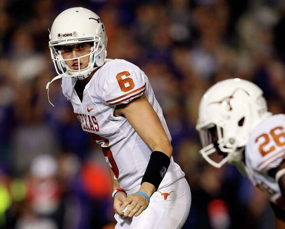 Quarterback Case McCoy #6 of the Texas Longhorns relays signals to D.J. Monroe #26 during the game against the Kansas State Wildcats at Bill Snyder Family Football Stadium on December 1, 2012 in Manhattan, Kansas. Photo: Jamie Squire, Getty Images / 2012 Getty Images