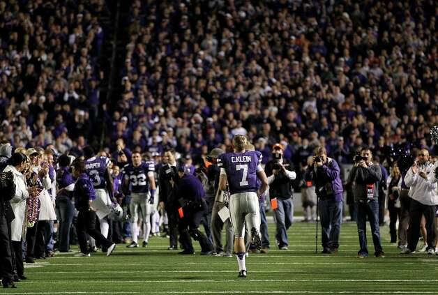 Quarterback Collin Klein #7 of the Kansas State Wildcats runs onto the field during player introduction prior to the game against the Texas Longhorns at Bill Snyder Family Football Stadium on December 1, 2012 in Manhattan, Kansas. Photo: Jamie Squire, Getty Images / 2012 Getty Images
