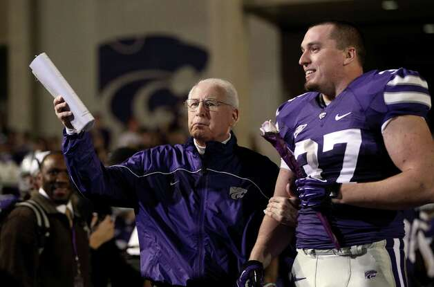 Head coach Bill Snyder of the Kansas State Wildcats waits with fullback Braden Wilson #37 during player introductions prior to the game against the Texas Longhorns at Bill Snyder Family Football Stadium on December 1, 2012 in Manhattan, Kansas. Photo: Jamie Squire, Getty Images / 2012 Getty Images
