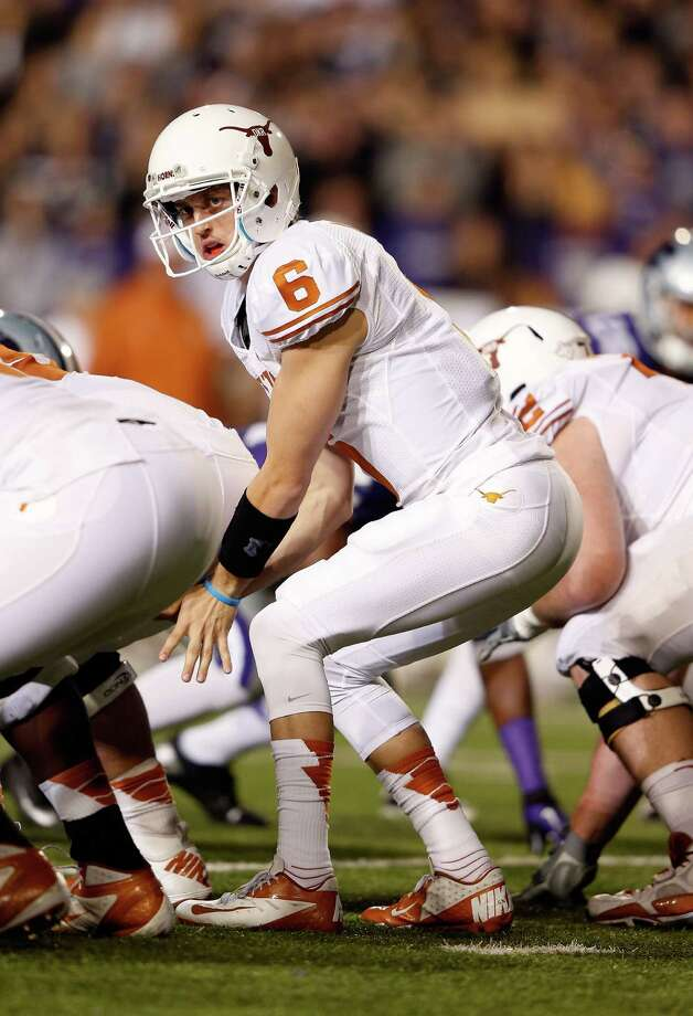 Quarterback Case McCoy #6 of the Texas Longhorns prepares to take a snap during the game against the Kansas State Wildcats at Bill Snyder Family Football Stadium on December 1, 2012 in Manhattan, Kansas. Photo: Jamie Squire, Getty Images / 2012 Getty Images