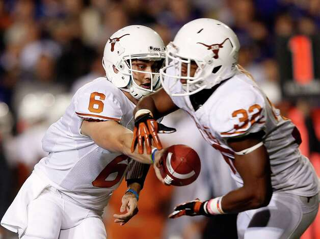 Quarterback Case McCoy #6 of the Texas Longhorns hands off to running back Johnathan Gray #32 during the game against the Kansas State Wildcats at Bill Snyder Family Football Stadium on December 1, 2012 in Manhattan, Kansas. Photo: Jamie Squire, Getty Images / 2012 Getty Images
