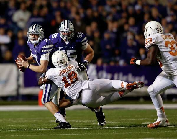 Quarterback Collin Klein #7 of the Kansas State Wildcats is sacked by linebacker Peter Jinkens #19 of the Texas Longhorns  during the game at Bill Snyder Family Football Stadium on December 1, 2012 in Manhattan, Kansas. Photo: Jamie Squire, Getty Images / 2012 Getty Images