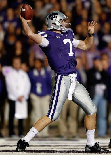 Quarterback Collin Klein #7 of the Kansas State Wildcats passes from his own end zone during the gam