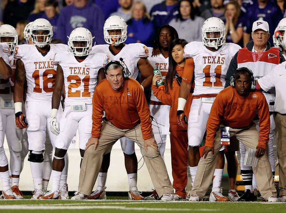 Head coach Mack Brown of the Texas Longhorns watches from the sidelines during the game against the Kansas State Wildcats at Bill Snyder Family Football Stadium on December 1, 2012 in Manhattan, Kansas. Photo: Jamie Squire, Getty Images / 2012 Getty Images