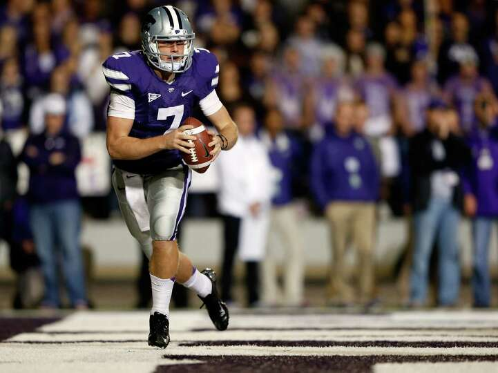 Quarterback Collin Klein #7 of the Kansas State Wildcats looks to pass from his own end zone during