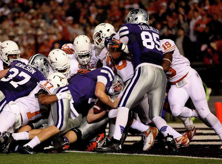 Quarterback Collin Klein #7 of the Kansas State Wildcats pushes across the goal line for a touchdown on a quarterback sneak during the game against the Texas Longhorns  at Bill Snyder Family Football Stadium on December 1, 2012 in Manhattan, Kansas. Photo: Jamie Squire, Getty Images / 2012 Getty Images
