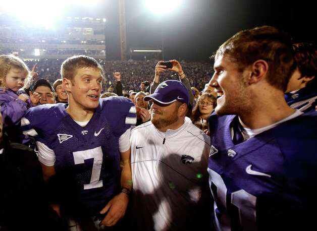 Quarterback Collin Klein #7 of the Kansas State Wildcats celebrates with brother, wide receiver Kyle Klein #81, following the Wildcats' 42-24 victory over the Texas Longhorns at Bill Snyder Family Football Stadium on December 1, 2012 in Manhattan, Kansas. Photo: Jamie Squire, Getty Images / 2012 Getty Images