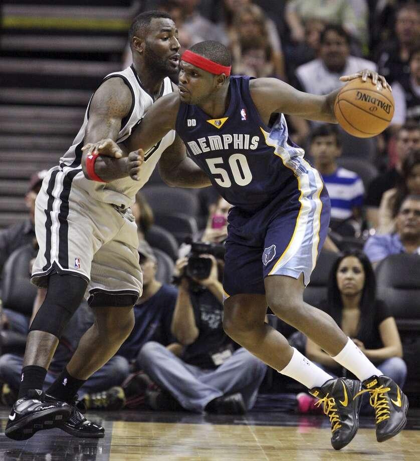 San Antonio Spurs' DeJuan Blair defends Memphis Grizzlies' Zach Randolph during first half action Saturday Dec. 1, 2012 at the AT&T Center. (Edward A. Ornelas / San Antonio Express-News)