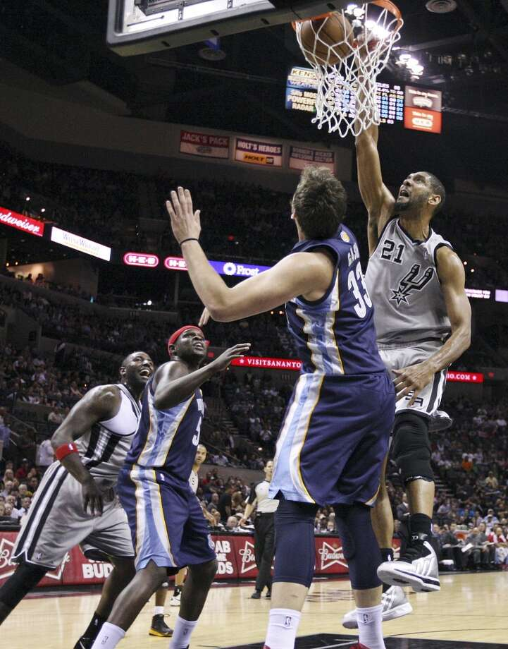 San Antonio Spurs' Tim Duncan dunks over Memphis Grizzlies' Marc Gasol during first half action Saturday Dec. 1, 2012 at the AT&T Center. (Edward A. Ornelas / San Antonio Express-News)