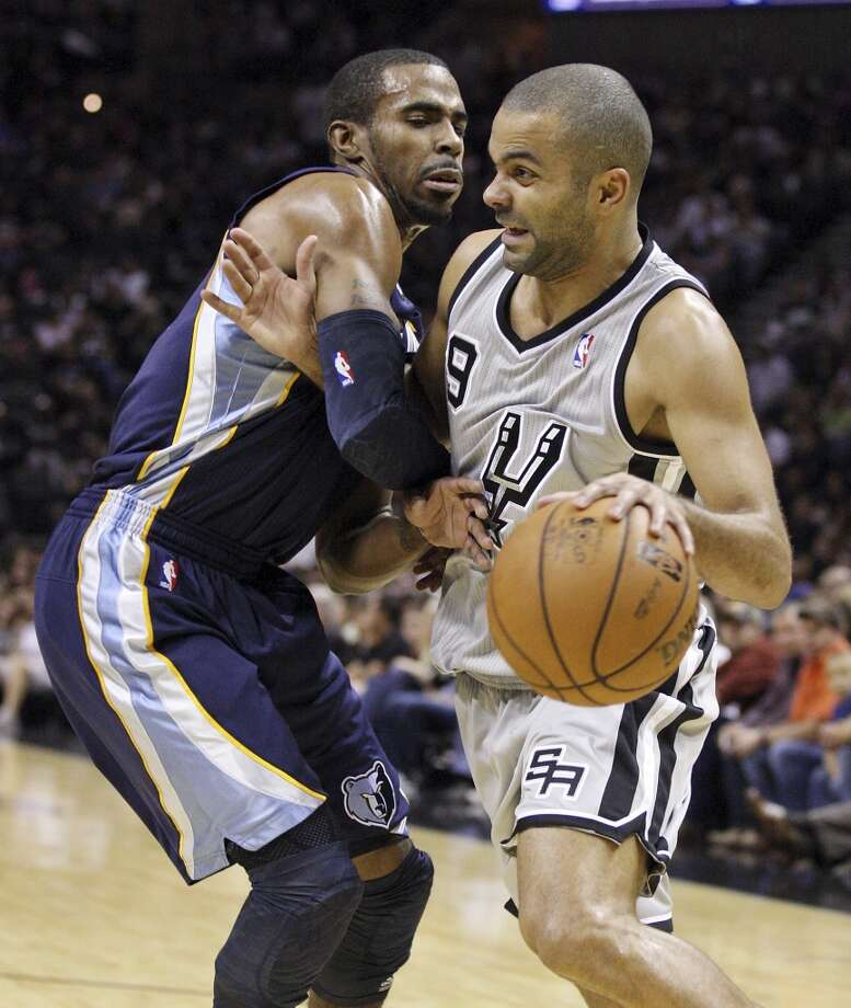 San Antonio Spurs' Tony Parker looks for room around Memphis Grizzlies' Mike Conley during first half action Saturday Dec. 1, 2012 at the AT&T Center. Parker was fouled on the play. (Edward A. Ornelas / San Antonio Express-News)