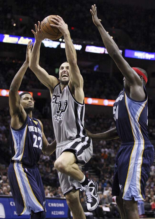 San Antonio Spurs' Manu Ginobili shoots between Grizzlies' Rudy Gay and Grizzlies' Zach Randolph during first half action Saturday Dec. 1, 2012 at the AT&T Center. (Edward A. Ornelas / San Antonio Express-News)