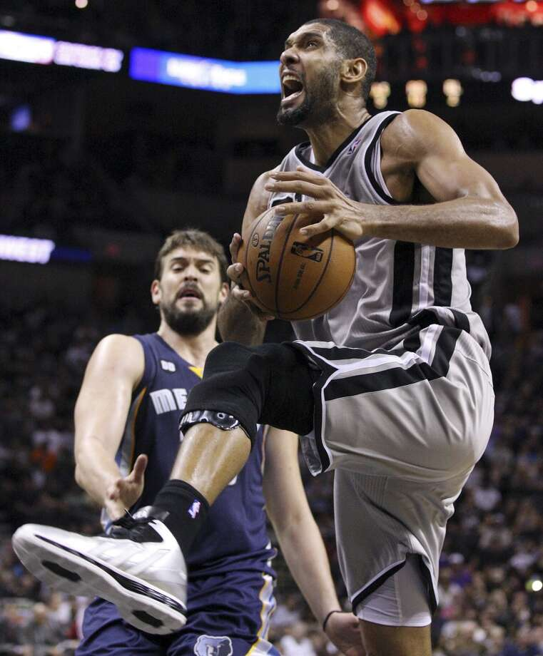 San Antonio Spurs' Tim Duncan reacts after being fouled by Memphis Grizzlies' Marc Gasol during first half action Saturday Dec. 1, 2012 at the AT&T Center. (Edward A. Ornelas / San Antonio Express-News)