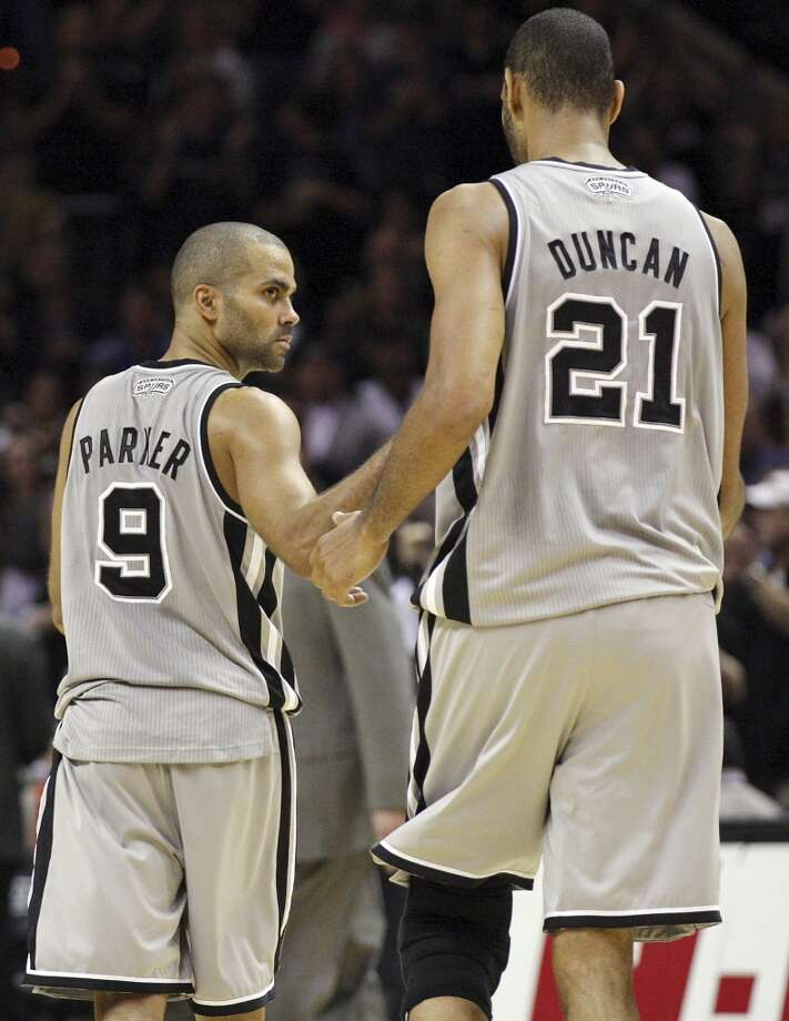 San Antonio Spurs' Tony Parker and teammate San Antonio Spurs' Tim Duncan react after Parker made two free throws against the Memphis Grizzlies late in overtime action Saturday Dec. 1, 2012 at the AT&T Center. The Spurs won 99-95. (Edward A. Ornelas / San Antonio Express-News)