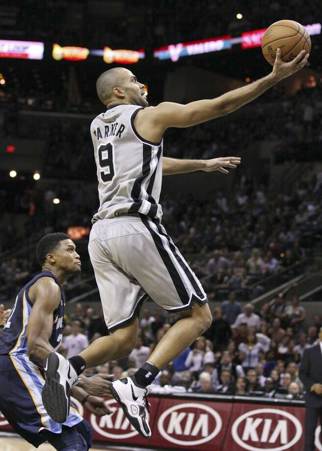 San Antonio Spurs' Tony Parker shoots around Memphis Grizzlies' Rudy Gay during overtime action Saturday Dec. 1, 2012 at the AT&T Center. Spurs won 99-95. (Edward A. Ornelas / San Antonio Express-News)