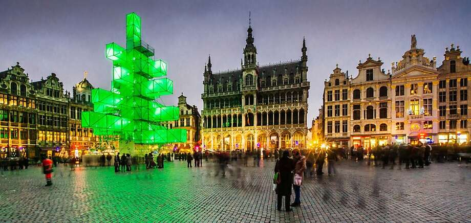 An abstract light installation replaces the traditional Christmas tree at the Grand Place in Brussels, Saturday Dec. 1, 2012. Traditionally, a 20m (65ft) pine tree from the forests of the Ardennes decorates the city's central square, the Grand Place. This year, it has been replaced with a 25m (82ft) construction. (AP Photo / Geert Vanden Wijngaert) Photo: Geert Vanden Wijngaert, Associated Press