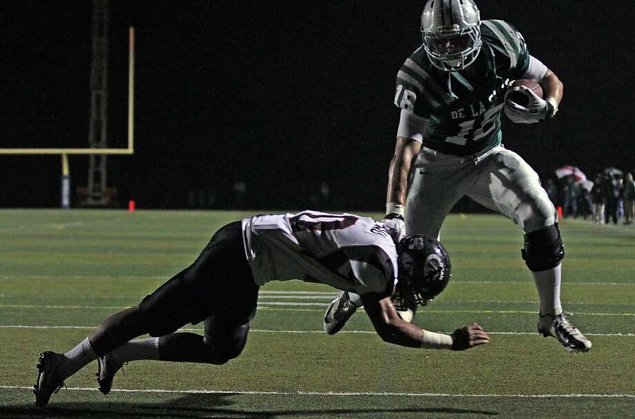 De La Salle Austin Hooper scores a touchdown against Logan High School in the first quarter of the NCS Division 1 title game Saturday Dec. 1, 2012, at Dublin High School in Dublin, Calif. Photo: Lance Iversen, The Chronicle