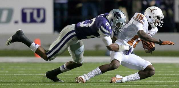 Kansas State defensive back Jarard Milo (23) tackles Texas wide receiver Bryant Jackson (16) during the first half of an NCAA college football game on Saturday, Dec. 1, 2012, in Manhattan, Kan. (AP Photo/Charlie Riedel) Photo: Charlie Riedel, Associated Press / AP