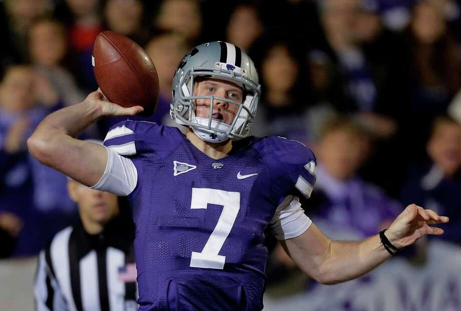 Kansas State quarterback Collin Klein throws during the first half of an NCAA college football game against Texas, Saturday, Dec. 1, 2012, in Manhattan, Kan. (AP Photo/Charlie Riedel) Photo: Charlie Riedel, Associated Press / AP