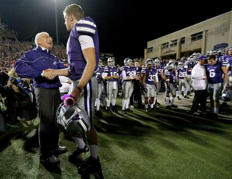 Kansas State coach Bill Snyder, left, talks to quarterback Collin Klein during a senior day recognition before an NCAA college football game against Texas, Saturday, Dec. 1, 2012, in Manhattan, Kan. (AP Photo/Charlie Riedel) Photo: Charlie Riedel, Associated Press / AP