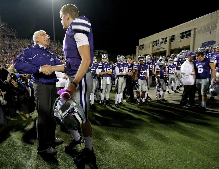 Kansas State coach Bill Snyder, left, talks to quarterback Collin Klein during a senior day recognit