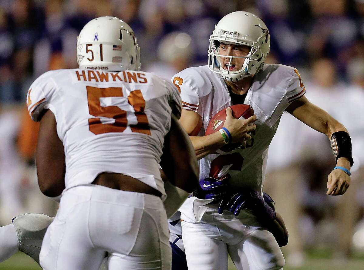 Texas quarterback Case McCoy (6) is sacked by Kansas State defensive end Meshak Williams during the first half of an NCAA college football game Saturday, Dec. 1, 2012, in Manhattan, Kan. (AP Photo/Charlie Riedel)