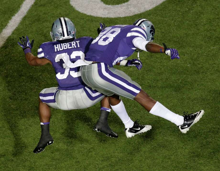 Kansas State running back John Hubert (33) celebrates with wide receiver Torell Miller (88) after scoring a touchdown during the second half of an NCAA college football game against Texas, Saturday, Dec. 1, 2012, in Manhattan, Kan. (AP Photo/Charlie Riedel) Photo: Charlie Riedel, Associated Press / AP