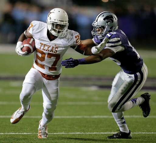 Texas wide receiver Michael Zaring (27) is pursued by Kansas State defensive back Randall Evans (15) during the first half of an NCAA college football game on Saturday, Dec. 1, 2012, in Manhattan, Kan. (AP Photo/Charlie Riedel) Photo: Charlie Riedel, Associated Press / AP