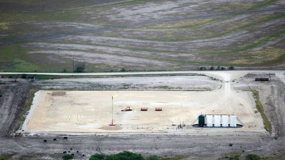 A finished well in the Eagle Ford shale oil play near Kenedy is seen in this Friday Nov. 23, 2012 aerial photo. Photo: William Luther, San Antonio Express-News / © 2012 San Antonio Express-News