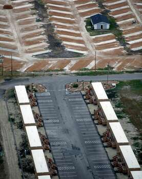 A so-called man camp, bottom, and a still-under-development RV park, top, are seen in this Friday Nov. 23, 2012 aerial photo in Kenedy, which lies in the Eagle Ford shale oil play. Photo: William Luther, San Antonio Express-News / © 2012 San Antonio Express-News