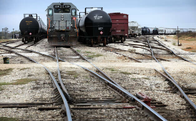 An engine, and rail cars wait to be used at Texas Gonzales and Northern Railway.  Operations at the Texas Gonzales and Northern Railway, just outside of Gonzales, Texas have taken off due to the increased business from the Eagle Ford.  Tuesday, Nov. 13, 2012. Photo: Bob Owen, San Antonio Express-News / © 2012 San Antonio Express-News