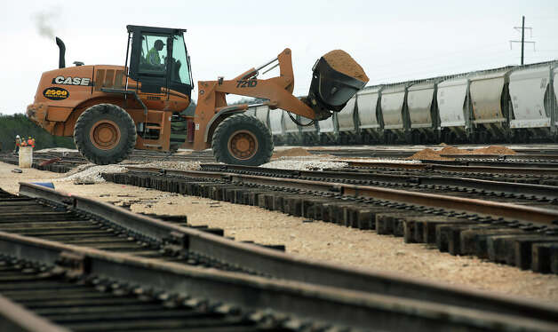 New track lines are covered with dirt at Texas Gonzales and Northern Railway.  Operations at the Texas Gonzales and Northern Railway, just outside of Gonzales, Texas have taken off due to the increased business from the Eagle Ford.  Tuesday, Nov. 13, 2012. Photo: Bob Owen, San Antonio Express-News / © 2012 San Antonio Express-News