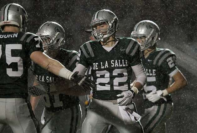 De La Salle Andrew Buckley (22) celebrates his touchdown catch in the fourth quarter with his teammates during their game with Logan High School for the NCS Division 1 title Saturday Dec. 1, 2012, at Dublin High School in Dublin, California. Photo: Lance Iversen, The Chronicle