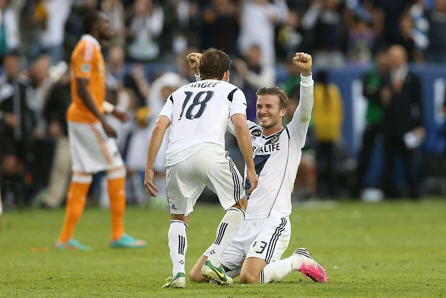 CARSON, CA - DECEMBER 01:  David Beckham #23 and Mike Magee #18 of Los Angeles Galaxy celebrate in t