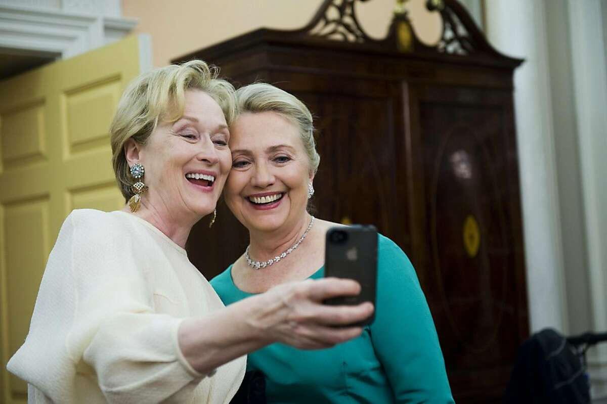 Soon to be uploaded to their Facebook pages: A pair of Kennedy Center Honors gala gals smile for an iPhone photo.