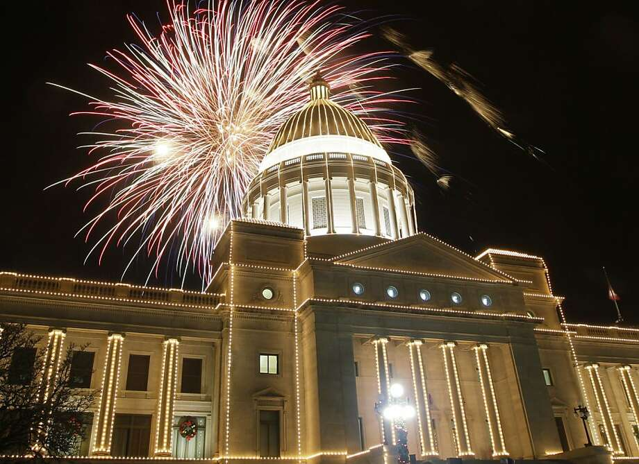 Fireworks explode over the Arkansas state Capitol during the annual Holiday lighting ceremony in Little Rock, Ark., Saturday, Dec. 1, 2012. (AP Photo/Danny Johnston) Photo: Danny Johnston, Associated Press