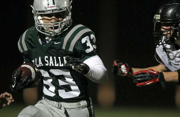 De La Salle Anthony Talaugon runs for a first down against Logan High School during the NCS Division 1 title game Saturday Dec. 1, 2012, at Dublin High School in Dublin, California. Photo: Lance Iversen, The Chronicle