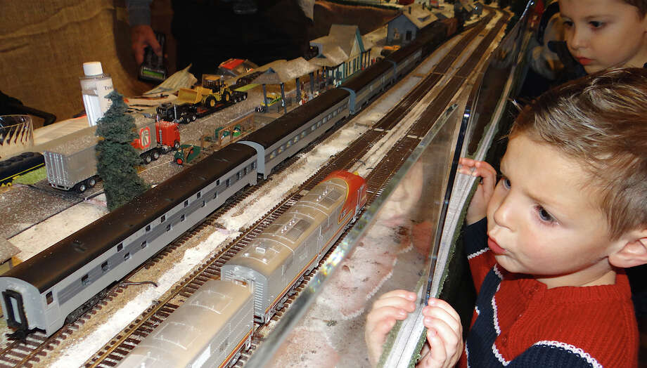 Three-year-old Jason Lengyel is fascinated by the H.O. trains passing by at the Holiday Express Train Show at the Fairfield Museum and History Center.  Fairfield CT 11/30/12 Photo: Mike Lauterborn / Fairfield Citizen contributed