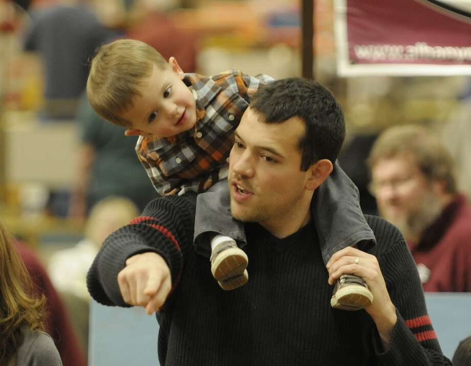 Joe Lindner Jr., 2, from Wilton, sits on the shoulders of his father, Joe Lindner, as they look over a working train display at the Great Train Extravaganza, 2011 on Sunday, Dec. 4, 2011 at the Empire State Convention Center in Albany, NY.  Lindner said that his father had brought him for 39 years to the show and so he was starting that tradition with his son, which was their second year at the show.  This years event had over  200 tables of model trains, train sets, parts and accessories for sale along with books, videos, prints, and railroad memorabilia.   The event is put on by the Upstate Train Associates and the Hudson-Berkshire Division of the National Model Railroad Association.  (Paul Buckowski / Times Union) (Albany Times Union)
