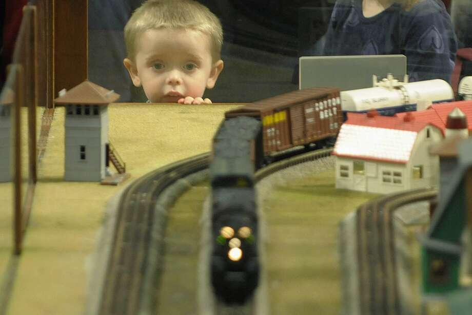 Brayden Doherty, 3, from Glenville watches intensely as a model train goes by during the Great Train Extravaganza, 2011 on Sunday, Dec. 4, 2011 at the Empire State Convention Center in Albany, NY.  Doherty's mother said that he has be obsessed with trains since he was one year old.  This years event had over  200 tables of model trains, train sets, parts and accessories for sale along with books, videos, prints, and railroad memorabilia.   The event is put on by the Upstate Train Associates and the Hudson-Berkshire Division of the National Model Railroad Association.  (Paul Buckowski / Times Union) (Albany Times Union)