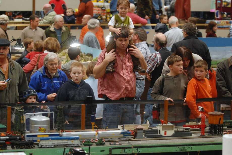 Visitors look over displays   during the Great Train Extravaganza put on by the Upstate Train Association and the Hudson Berkshire Division of the National Model Railroad Association, at the Empire State Plaza in Albany, NY on Sunday, Dec. 6, 2009.  This years show had 72 vendors with 211 tables of railroad merchandise.   Money raised through the show helps the Upstate Train Association put on the model train display at the Schenectady Museum through Christmas and the Hudson Berkshire Division of the National Model Railroad Association uses the funds to purchase train sets that are given away through the Toys for Tots program.  This year 120 train sets were given away.  (Paul Buckowski / Times Union) (ALBANY TIMES UNION)