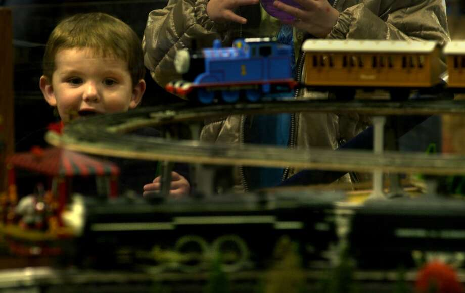 Times Union Staff Photo By Paul Buckowski --  Mark Mills, , 22 months old, of Cobelskill, NY, watches as a train comes around on one of the displays at the Great Train Extravaganza 2000, at the Empire State Plaza, on Sunday December 3, 2000. (DG)