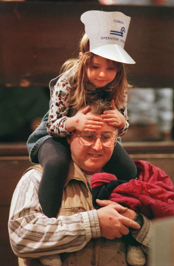 Times Union photo by PAUL BUCKOWSKI -- SUNDAY DECEMBER 7 1997 -- ALBANY NY -- GREAT TRAIN EXTRAVAGANZA --  Joe Belschwinder, of Schodack, gives his three year old daughter, Kayla a lift so she can view some of the  train displays  at the 1997 Great Train Extravaganza at the Empire State Plaza Convention Center go around a track Sunday morning. (DG)