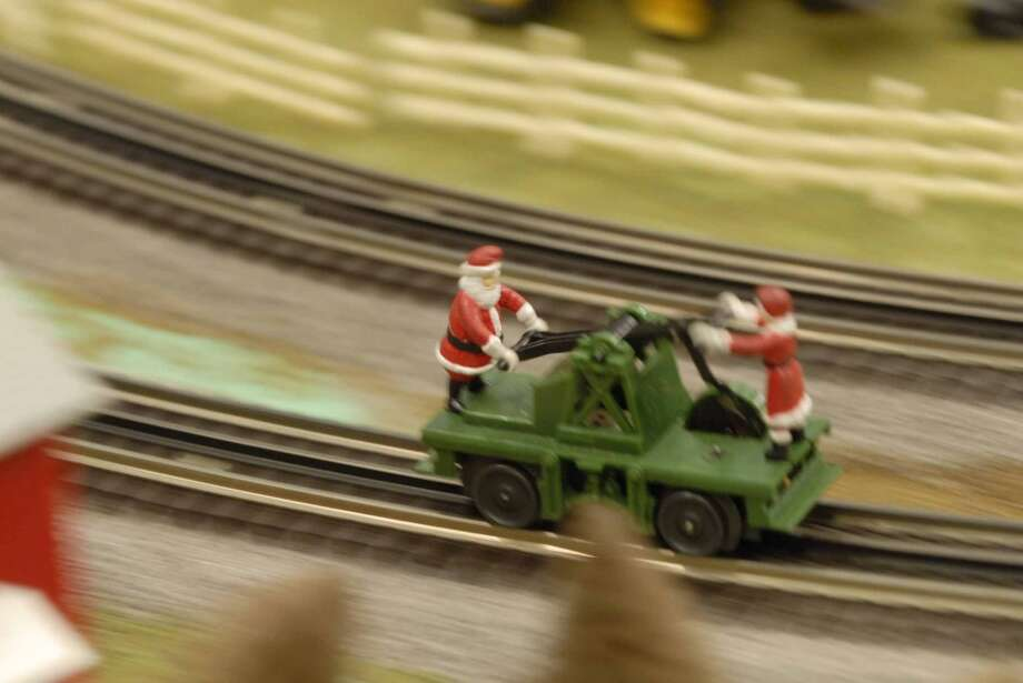 Times Union staff photo by Paul Buckowski ---     A car moves on the tracks of Santa and Mrs. Clause on Sunday, Dec. 2, 2007 during the Great Train Extravaganza 2007 at the Empire State Plaza Convention Center in Albany, NY.   The event brought 75 vendors together this year.  The event is held the first Sunday in December and is the put on by the Upstate Train Associates and it is their one fundraiser of the year.  The large working train display that the Upstate Train Associates have on display will move to the  Schenectady Museum and will be on display starting Dec. 8th and will be running on weekends and on holiday week so children off from school can view it.  It will be on display through January at the museum. (Hearst)