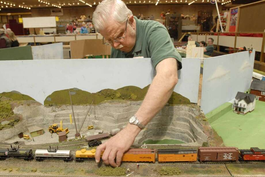 Times Union staff photo by Paul Buckowski ---     Dave Hoadley, from Halfmoon, NY, and member of The Catskill, Adirondack and Berkshire Railroad club, sets up some H-O scale trains to run on the tracks  on Sunday, Dec. 2, 2007 during the Great Train Extravaganza 2007 at the Empire State Plaza Convention Center in Albany, NY.   The event brought 75 vendors together this year.  The event is held the first Sunday in December and is the put on by the Upstate Train Associates and it is their one fundraiser of the year. (Hearst)